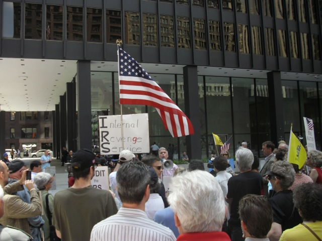 Former Congressman? WIND radio host Joe Walsh addresses the crowd at IRS protest in Chicago, Illinois