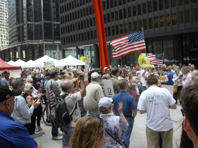 Over a hundred  IRS protesters gather at Federal Plaza in Chicago, Illinois